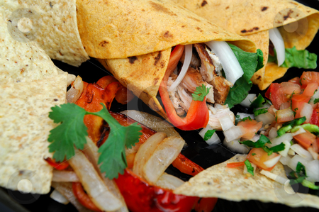 Close-up Chicken Wrap And Chips stock photo, Spicy chicken wrap stuffed grilled meat, bell pepper, onions and cilantro with salsa and tortilla chips by Lynn Bendickson