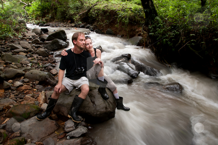 European and American couple in Costa Rica stock photo, European and American couple in Costa Rica near river by Scott Griessel