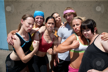 We run for fun and look good too. stock photo, Group of runners pose after a race. by Scott Griessel