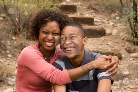 African-American single-parent family stock photo, Happy single-mother and teen son by Scott Griessel