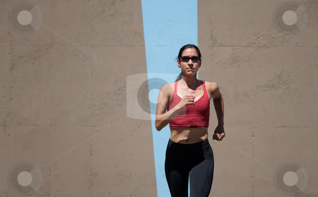 Single woman running stock photo, Woman out for a run. by Scott Griessel