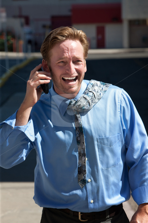 Pleased, good-looking guy talks on cell phone. stock photo, Handsome man is excited about his phone call. by Scott Griessel