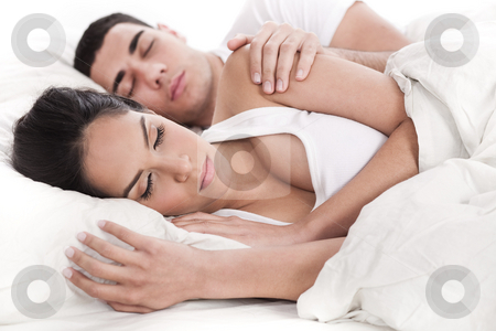 Couple lying in bed sleeping together stock photo, Couple lying in bed sleeping together over white background by Get4net