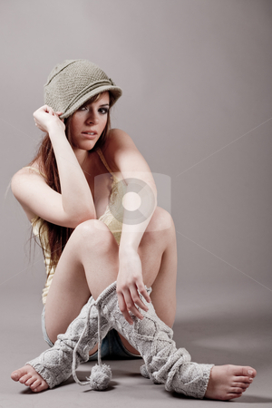 Young model sitting in autumn clothes stock photo, Young model sitting in autumn clothes on a light background by Get4net
