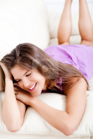 Young girl imagine and embrassing stock photo, Young woman smile and laying on the sofa by Get4net 