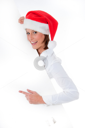 Female Santa pointing down at blank billboard stock photo, Happy Female Santa pointing down at blank billboard, isolated background by Get4net