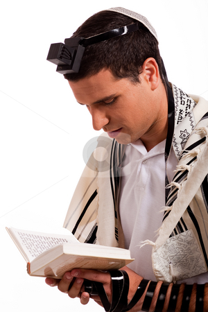 Close up of a young  jewish man with book stock photo, Close up of a young  jewish man with book on white isolated background by Get4net