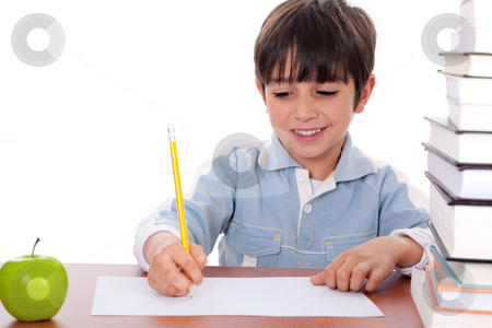 School boy doing his homework with an apple beside him stock photo, School boy doing his homework with an apple beside him on white background by Get4net