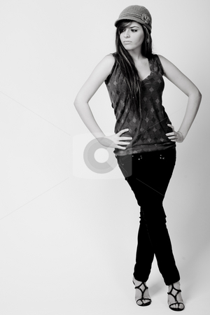 Full length black and white image of a brunette model stock photo, Full length black and white image of a brunette model on a light background by Get4net