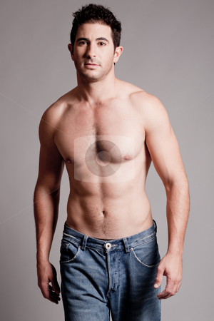 Shirtless man walking stock photo, Shirtless man walking in a grey isolated backround by Get4net