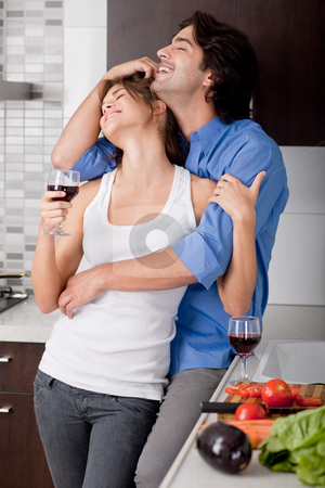 Young couple hug stock photo, Young couple hug in their kitchen by Get4net