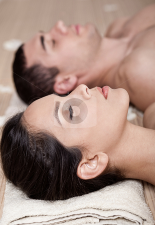 Resting couple in a spa stock photo, Resting couple in a spa over bamboo mat by Get4net