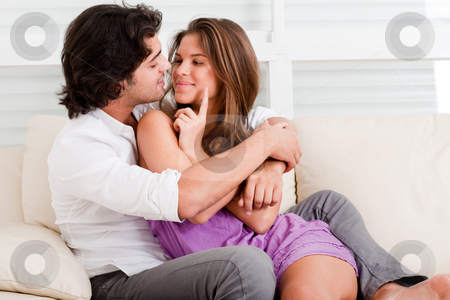 Couple in love stock photo, Romantic couple in couch by Get4net