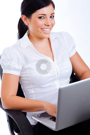 Young attractive business woman smiling while surfing the net stock photo, Young attractive business woman smiling while surfing the net ,Indoor studio by Get4net 