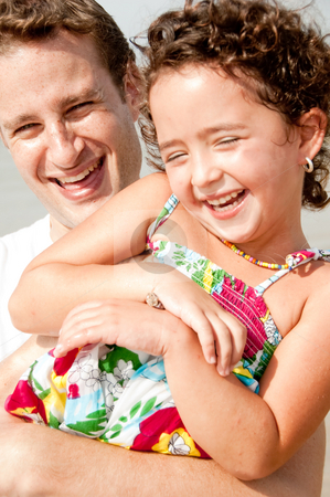 Father and daughter stock photo, Father and daughter playing in the beach by Get4net