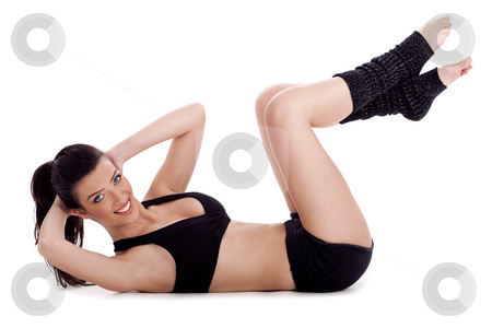 Fitness instructor doing situp exercise and turning to camera stock photo, Fitness instructor doing situp exercise and turning to camera over white background by Get4net
