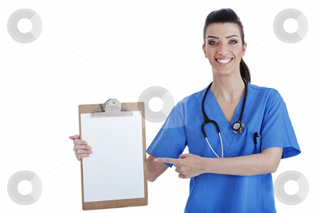 Portrait of young nurse pointing blank clipboard stock photo, Portrait of young nurse pointing blank clipboard over isolated white background by Get4net