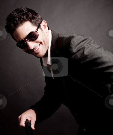 Portrait of young Trendy Business man smiling stock photo, Portrait of young Trendy Business man smiling,indoor studio by Get4net