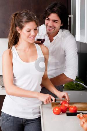 Happy young couple in the kitchen stock photo, Happy young couple in love at the kitchen by Get4net