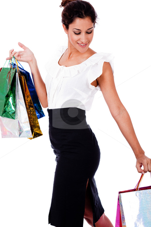 Portrait of a young woman holding a shopping bags stock photo, Portrait of a young woman holding a shopping bags on siolated background by Get4net