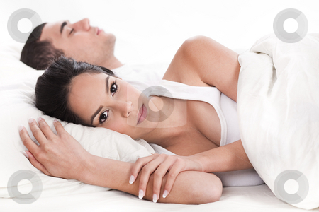 Couple in bed, men sleeping and woman lying sleepless stock photo, Couple in bed, men sleeping and woman lying sleepless in white background by Get4net