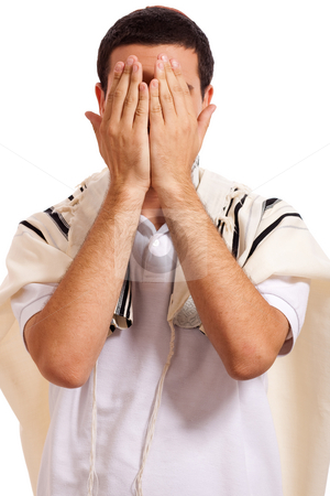Jewish man closing face with his hands while praying stock photo, Portrait of jewish man closing face with his hands while praying on a white isolated background by Get4net