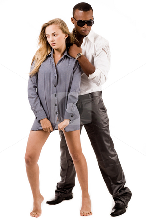 Full length image of sexy lady and stylish young black man standing stock photo, Full length image of sexy lady and stylish young black man standing indoor studio by Get4net