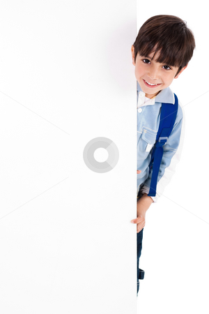 Young kid silently standing behind the board stock photo, Young kid silently standing behind the board on white isolated background by Get4net 