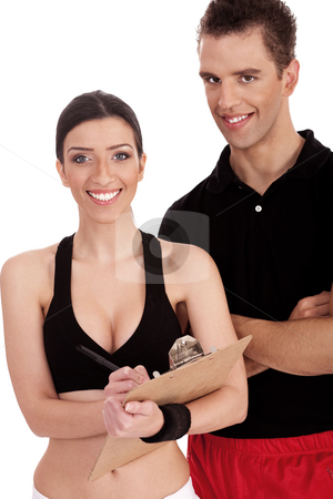 Fitness trainers folded their hands stock photo, Fitness trainers folded their hands over white background by Get4net