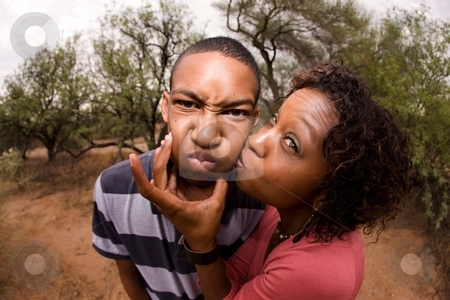African-American family making faces stock photo, Single-parent mom and son being silly outdorrs by Scott Griessel