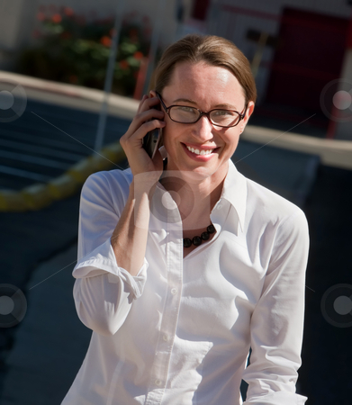 Beautiful woman smiles as she talks on cell phone. stock photo, Happy young woman joyfully talks on cell phone by Scott Griessel