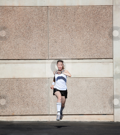 Speedy woman runs for fun. stock photo, Pretty woman times herself running. by Scott Griessel