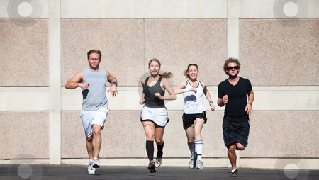 Good-looking couples out for a morning run. stock photo, Two couples running for fun. by Scott Griessel
