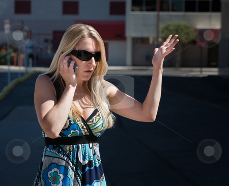 Pretty woman talks cell phone. stock photo, Woman is confused by what she hears. by Scott Griessel