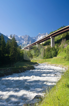 Alpine highway stock photo, Bridge over Dora Baltea river near Courmayeur, Aosta Valley, Italy by ANTONIO SCARPI