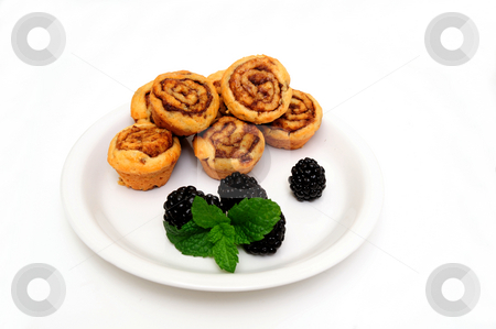 Mini Cinnamon Rolls And Blackberry stock photo, Sweet and delicious cinnamon rolls with fresh ripe black berries and a mint leaf garnish ready for a light breakfast or snack by Lynn Bendickson