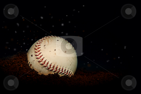 Baseball dropping in the dirt  stock photo, Baseball dropping in the dirt by Michiel De Wit