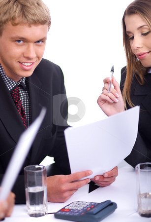 Confident  businessmen with his collegue  stock photo, Confident  businessmen with his collegue  holding his document and looking at you over white background by Get4net