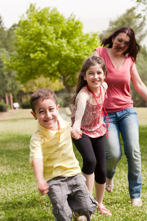 Family of three play in the park stock photo, Family of three running in the park son on the front by Get4net 