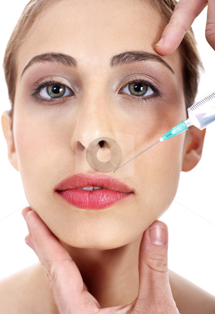 Young woman being injected botox on her lips stock photo, Close up of a young woman being injected botox on her lips over isolated white baclground by Get4net