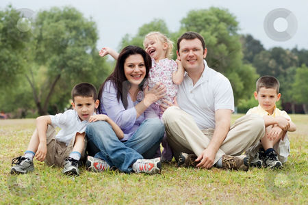 Portrait of happy family of five on the green land stock photo, Portrait of happy family of five on the green land over natural background by Get4net 