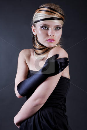 Beautiful young Female model stock photo, Beautiful young Female modell wearing black hand glove in her right hand by Get4net