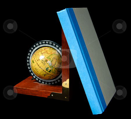 Wooden Bookend stock photo, A bookend in the shape of a world globe, shot against a dark background by Richard Nelson