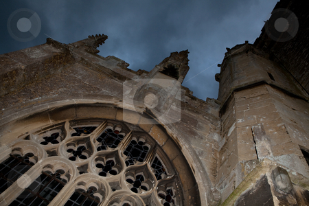 Halloween church stock photo, Dark clouds above an English 15th century medieval church ruin (shot in Lacock village, England, a Harry Potter film location) by Anneke