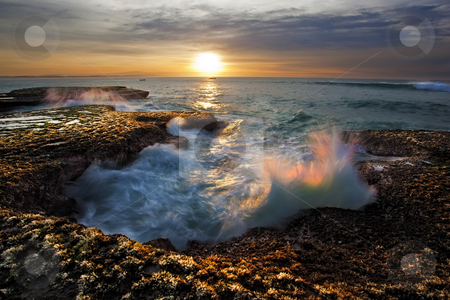 Wave Sunrise stock photo, Image of a sunrise on the coast in the Republic of South Africa. by Kobus Tollig
