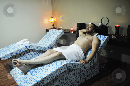 Man relaxing at spa stock photo, Young beautiful man relaxing at spa and wellness center at hot bed with blue tiles decoration by Benis Arapovic