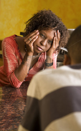 African-American couple talks in kitchen stock photo, Concerned African-American woman and man in interior setting by Scott Griessel