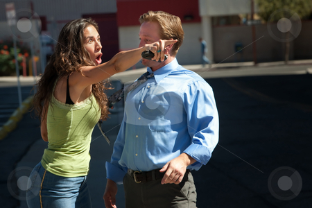 Two friends shocked by what is seen. stock photo, Man and woman have intense discussion on a city street. by Scott Griessel