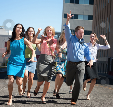 Stylish, happy people running in the city. stock photo, Happy men and women running down the street. by Scott Griessel