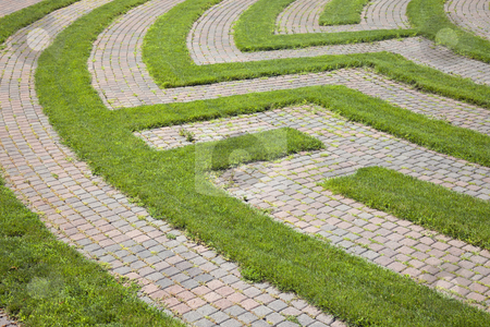 Grass and Cobblestone Maze stock photo, Park maze with a cobblestone walkway and grass boundaries. Horizontal shot. by Edward Bock